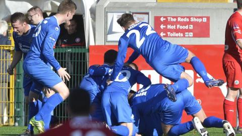 Dungannon Swifts players celebrate after a late Ryan Brown own goal gave them a 1-1 draw away to Premiership champions Cliftonville