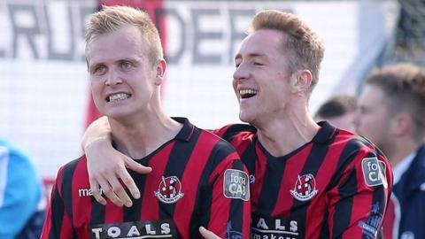 Jordan Owens and Timmy Adamson scored for Crusaders in their 3-0 Irish Premiership victory away to Warrenpoint Town
