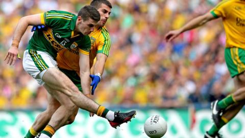 Paul Geaney shoots low into the Donegal net to give Kerry the perfect start in the senior decider