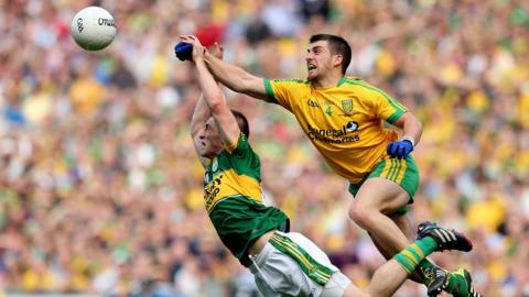 Kingdom forward Stephen O'Brien attempts to get to the ball ahead of Paddy McGrath