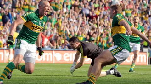 A delighted Kieran Donaghy celebrates as Donegal keeper Paul Durcan rues his mistake which led to the forward's second-half goal