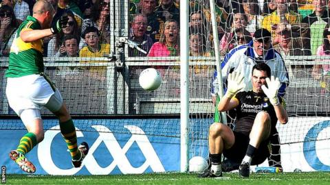 Kieran Donaghy shoots past Paul Durcan for Kerry's second goal in the All-Ireland Final
