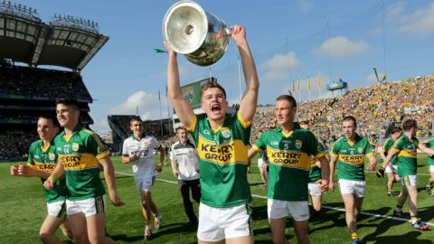 Ivan Parker holds the Tom Markham Cup loft as Kerry celebrate their 0-17 to 1-10 victory over Donegal in the minor decider