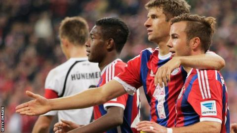 Mario Gotze (right) is congratulated by Thomas Muller (centre)