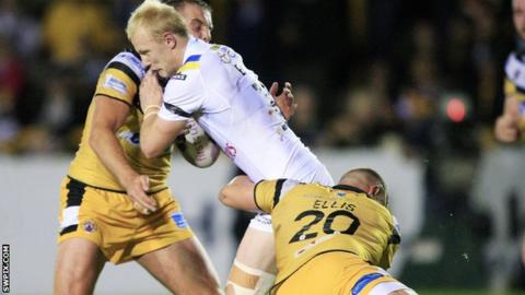 Warrington's Rhys Evans tackled by Castleford players