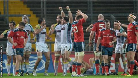 Ospreys players celebrate victory after the final whistle at Thomond Park