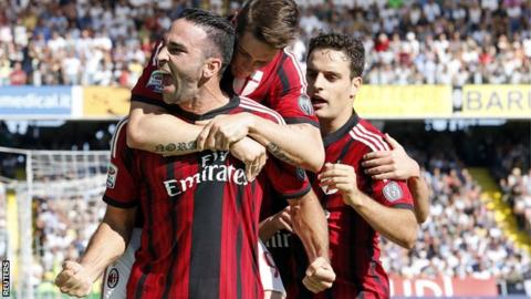 AC Milan celebrate Adil Rami's equaliser at Cesena