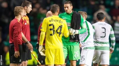 Goalkeepers Eduardo and Craig Gordon shake hands after the game at Celtic Park