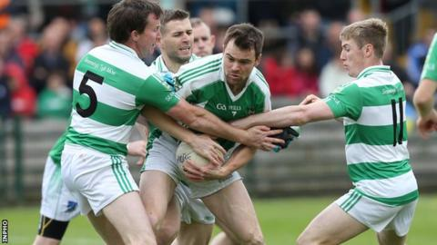 Teemore trio Declan McDonald, Damien Lee and Cian McManus tackle Roslea's Marty Beagan in the Fermanagh final