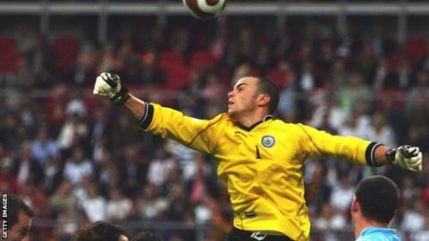 San Marino keeper Aldo Simoncini comes out to try to punch away across against Germany