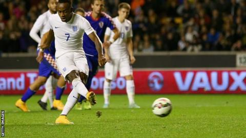 West Brom striker Saido Berahino scores a late penalty as England's Under-21s beat Croatia in their Euro 2015 play-off first leg