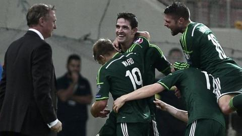 Kyle Lafferty is embraced after scoring Northern Ireland's second goal against Greece