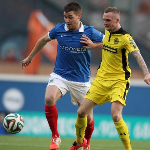 Stephen Lowry of Linfield in action against Cliftonville's Jude Winchester