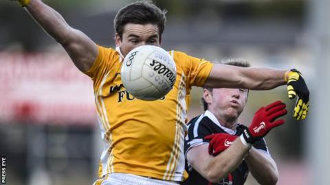 Clontibret's Dessie Mone gets to the ball ahead of Conor Laverty of Kilcoo