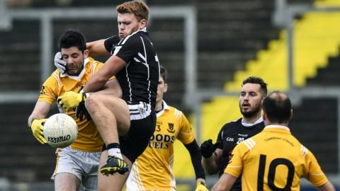 Clontibret's Gerard McEvoy gets an unwelcome companion in the form of Liam Savage in the Ulster Club SFC preliminary round game against Kilcoo at Pairc Esler
