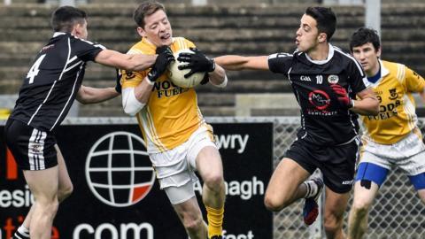 Kilcoo pair Daryl Brannigan and Ryan Johnson attempt to halt the run of Clontibret forward Conor McManus