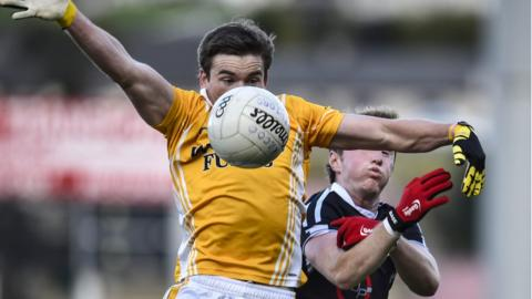 Clontibret's Dessie Mone, who scored a last-gasp goal to secure a 1-9 to 0-11 win over over Kilcoo, shields the ball from Conor Laverty