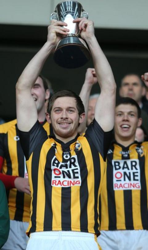 Johnny Hanratty lifts the trophy after a 4-14 to 0-9 hammering of Armagh Harps secures an 18th county title in 19 years for Crossmaglen Rangers