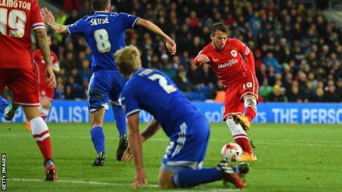 Adam Le Fondre shoots to score Cardiff's third goal against Ipswich