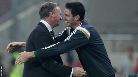 Michael O'Neill and Kyle Lafferty embrace after Northern Ireland's win in Athens