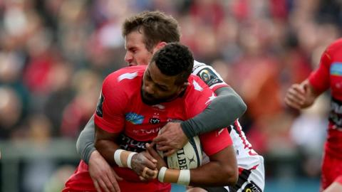 Ulster outside centre Jared Payne gets to grips with Toulon winger Delon Armitage