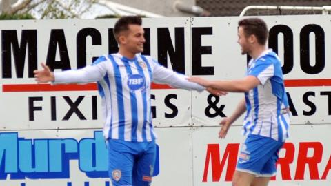 Mark Miskimmin accepts plaudits from David Scullion after scoring for Coleraine in the second minute of their 2-0 win at Portadown