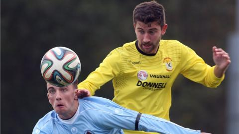 Institute's Paul McVeigh and Cameron Grieve of Dungannon keep their eyes on the ball