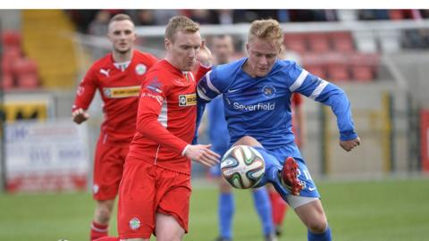 Chris Curran and John Curran contend for the ball during Cliftonville's 3-2 victory over Ballinamallard