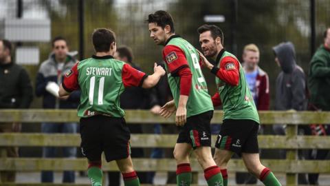 Glentoran hat-trick hero Curtis Allen is greeted by team-mates Jordan Stewart and David Scullion at Milltown