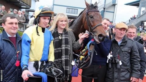 Jockey Mark Walsh with Little King Robin and the mare's connections after her WKD Hurdle triumph