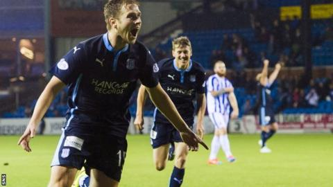Greg Stewart celebrates after scoring late on to make it 3-1 to Dundee at Rugby Park