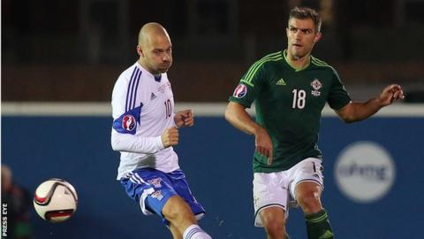 Aaron Hughes in action against the Faroe Islands last month