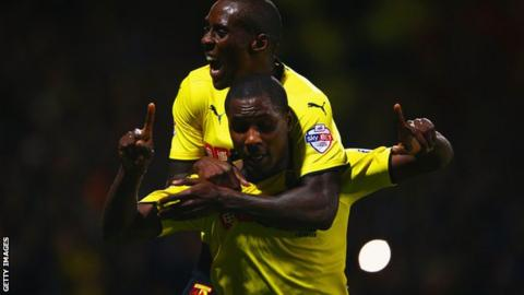 Odion Ighalo celebrates a Watford goal with Lloyd Dyer