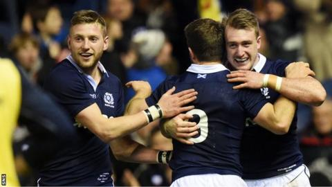 Finn Russell and Greig Laidlaw congratulate Stuart Hogg on his try