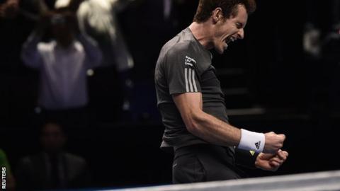 Andy Murray celebrates beating Milos Raonic