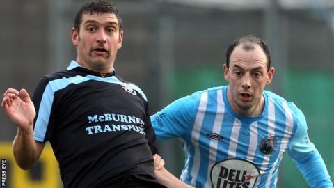 Matt Tipton of Ballymena United in action against Warrenpoint Town's Johnny Cowan