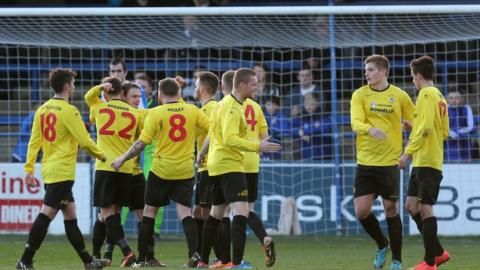 Dungannon celebrate after Andrew Mitchell scores the second goal in a 2-0 victory over the Bannsiders