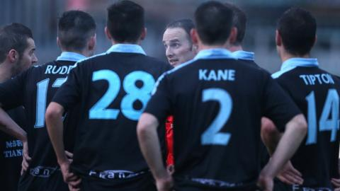 Referee Evan Boyce explains to Ballymena players his decision to stop the game at Milltown because of floodlight failure with United leading 2-1. Play resumed after repairs and Warrenpoint equalised to secure a draw