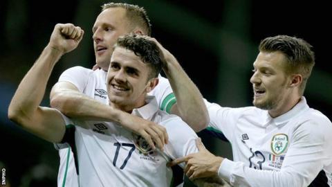 Robbie Brady is congratulated by David Meyler and Anthony Pilkington