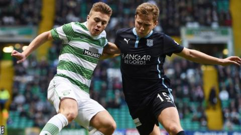 Celtic's James Forrest (left) retains possession from Dundee's Greg Stewart in the home side's 2-1 win.