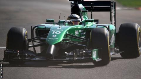 Caterham car of Kamui Kobayashi competing at the Abu Dhabi Grand Prix