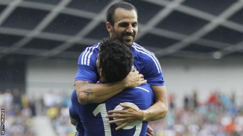 Cesc Fabregas celebrates with Diego Costa