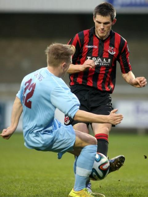 Matty Young of Institute challenges Crusaders defender Craig McClean for the ball during the 1-1 draw at Drumahoe