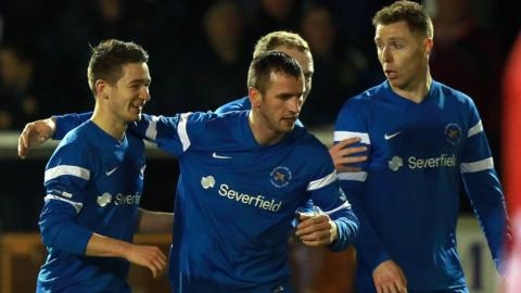 Liam Martin is congratulated after scoring in Ballinamallard's 3-1 home win over bottom club Warrenpoint Town