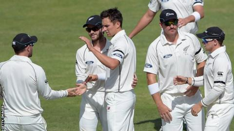 Trent Boult (centre) is congratulated