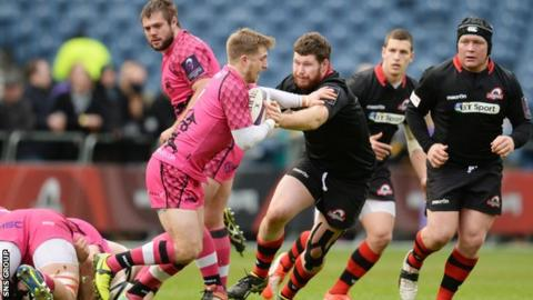 Edinburgh's James Hilterbrand (right) closes down Paul Rowely