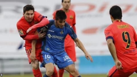 Lionel Messi vies with Getafe midfielder Pablo Sarabia