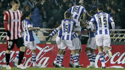 Real Sociedad celebrate taking the lead against Athletic Bilbao inthe Basque derby