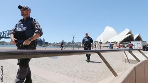 Armed police patrol near the Sydney Opera House