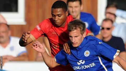 Kane Richards challenges Leicester City's Marc Albrighton in a pre-season friendly